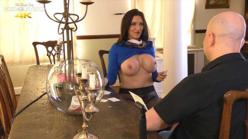 Miss Hybrid tits out at the castle table.
