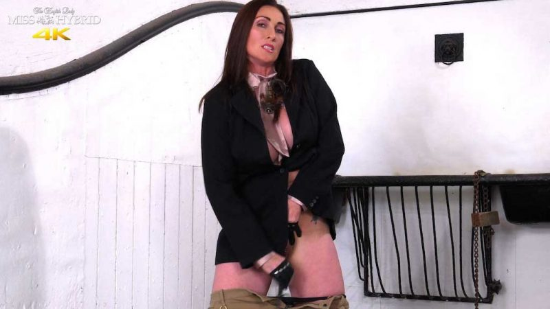 Miss Hybrid sexy thigh boots and jodhpurs, leather gloves playing with her dildo in the stables.