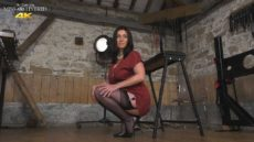 Miss Hybrid dungeon giantess mistress stands above you as you gaze up at her stocking clad legs.